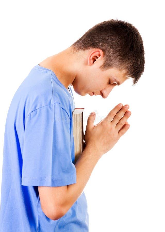 άτομο ανασκόπησης που προσεύχεται τις λευκές νεολαίες στοκ φωτογραφία