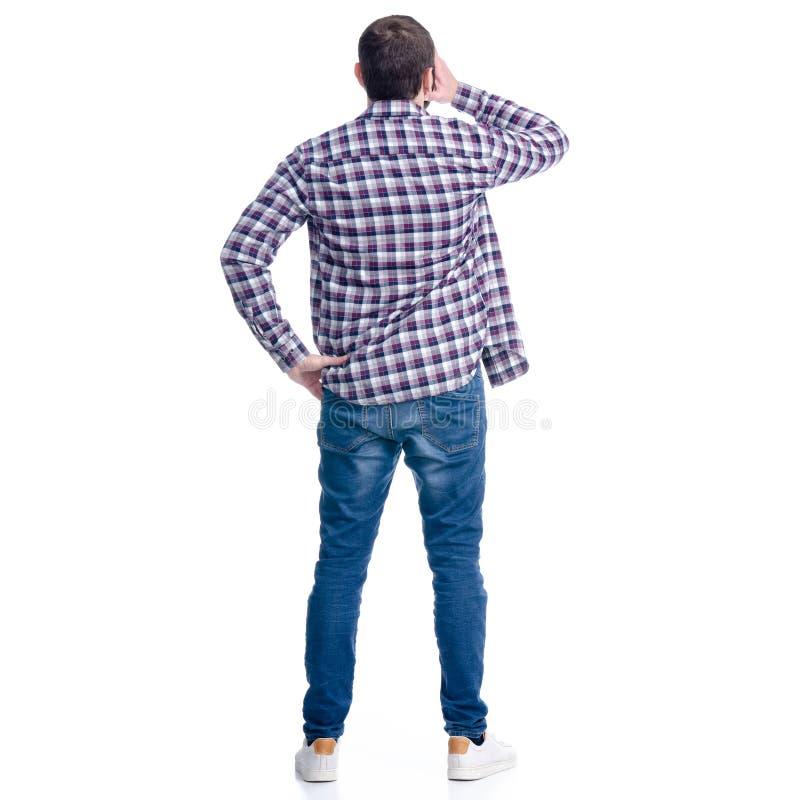 Άτομο στα τζιν και πουκάμισο που κρατά το κεφάλι του στοκ εικόνα με δικαίωμα ελεύθερης χρήσης