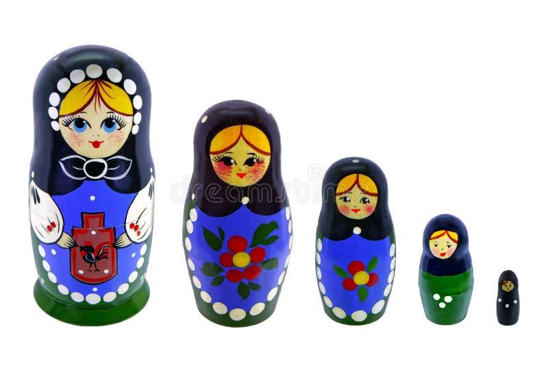 Αναμνηστικό πέντε παιχνιδιών όμορφες ρωσικές να τοποθετηθεί κούκλες στοκ εικόνες με δικαίωμα ελεύθερης χρήσης