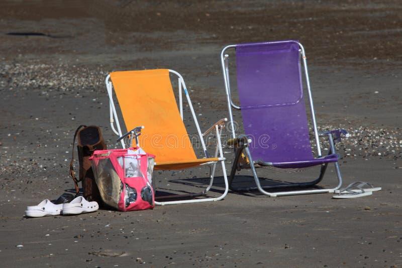 Αργόσχολος ήλιων στην παραλία στοκ φωτογραφία