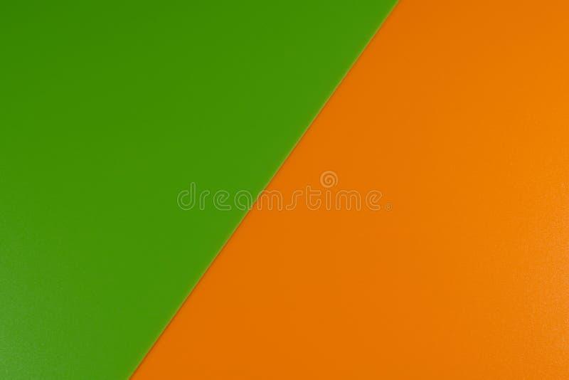 Αφηρημένη σύσταση υποβάθρου της πλαστικής επιφάνειας των πορτοκαλιών και πράσινων χρωμάτων στοκ εικόνα με δικαίωμα ελεύθερης χρήσης