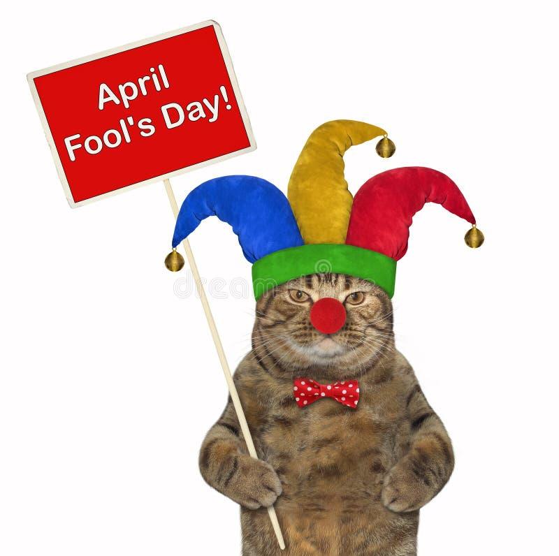 Γάτα σε ένα jester καπέλο με μια αφίσα στοκ φωτογραφία με δικαίωμα ελεύθερης χρήσης