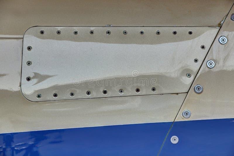 Ελαφριά αεριωθούμενη επιτροπή σωμάτων αεροπλάνων με την αφθονία των βιδών στοκ φωτογραφία με δικαίωμα ελεύθερης χρήσης