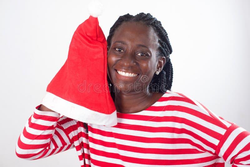 Ευτυχής νέα γυναίκα με το καπέλο Santa στοκ φωτογραφία με δικαίωμα ελεύθερης χρήσης