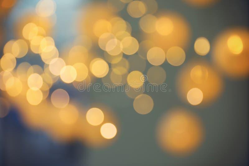 Θολωμένη άποψη των χρυσών φω'των στο σκοτάδι Επίδραση Bokeh στοκ εικόνες με δικαίωμα ελεύθερης χρήσης