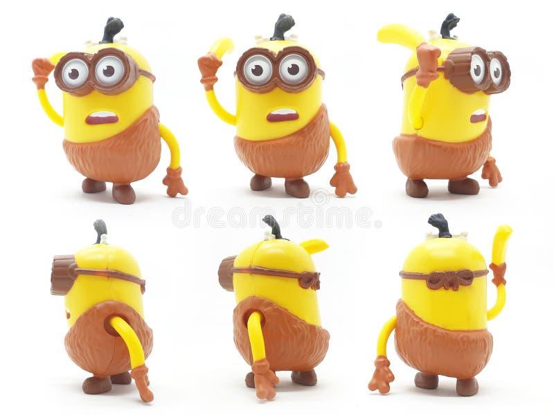 Κίτρινο πλαστικό πρότυπο παιχνιδιών Minion μπανανών από αξιοκαταφρόνητο εγώ κινηματογράφος απομονωμένο στο λευκό υπόβαθρο ελεύθερη απεικόνιση δικαιώματος