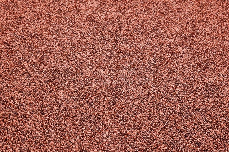 Κινηματογράφηση σε πρώτο πλάνο του τάπητα πολυεστέρα  κόκκινα χρώματα earthtone απεικόνιση αποθεμάτων
