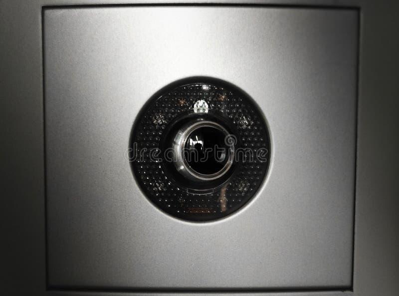 Κρυμμένο υπόβαθρο ματιών καμερών κατασκόπων στοκ εικόνα