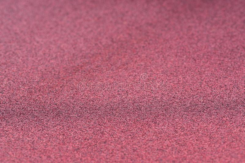 Κόκκινη λαμπρή εκλεκτική εστίαση υποβάθρου σύστασης στοκ φωτογραφία με δικαίωμα ελεύθερης χρήσης