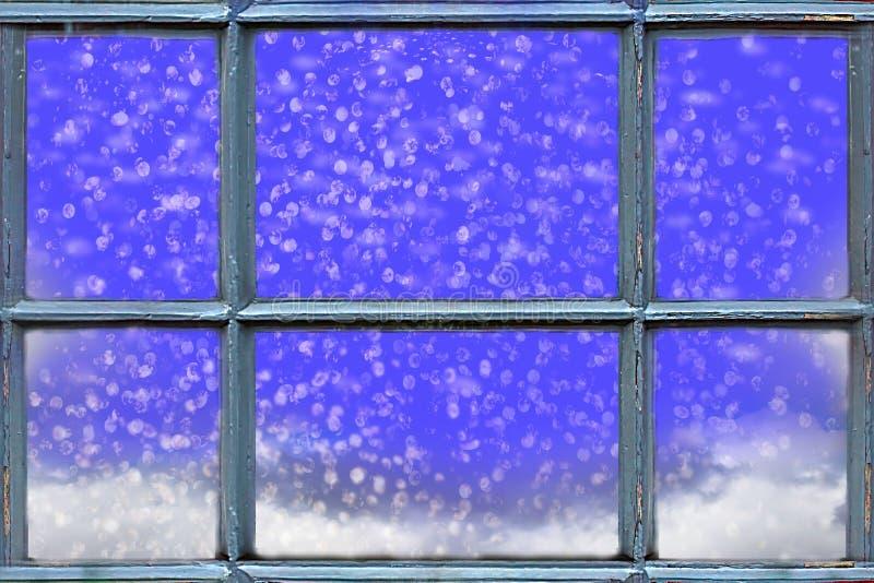 Μειωμένο χιόνι έξω από το παράθυρο στοκ φωτογραφίες