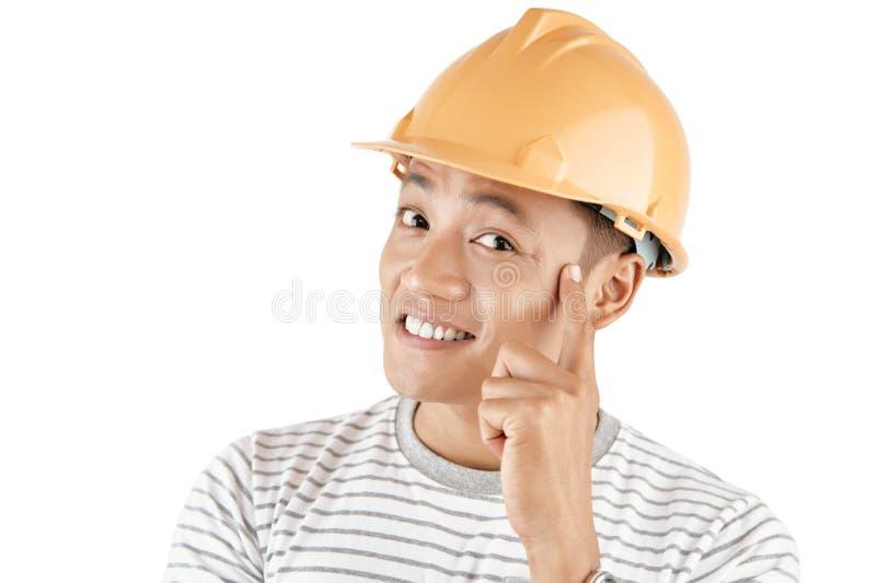 Νέος δημιουργικός εργάτης οικοδομών στοκ φωτογραφίες