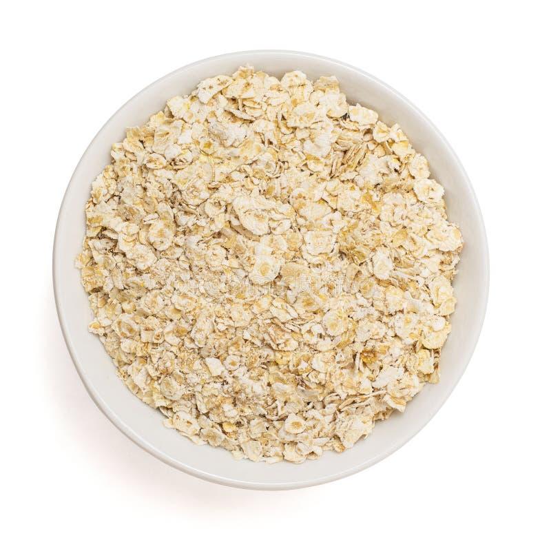 Ξεράνετε κυλημένο oatmeal στο κύπελλο που απομονώνεται στο άσπρο υπόβαθρο Τοπ όψη στοκ φωτογραφία με δικαίωμα ελεύθερης χρήσης