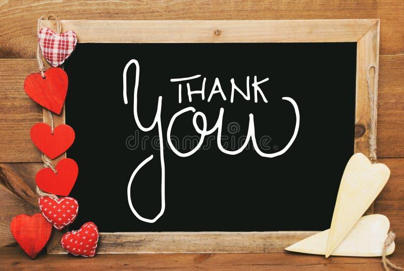 Οι κόκκινων και κίτρινων καρδιές Chalkbord, καλλιγραφία σας ευχαριστούν στοκ φωτογραφία