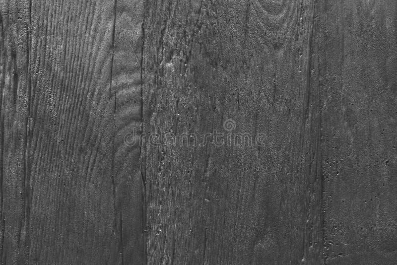Ο Μαύρος υποβάθρου της πέτρας με μια ξύλινη σύσταση σιταριού Η σύσταση ανακούφισης της πέτρας είναι τραχιά στοκ φωτογραφίες με δικαίωμα ελεύθερης χρήσης