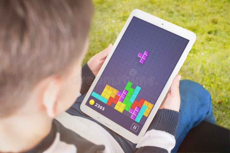 Δημοφιλές gane παιδικού παιχνιδιού στην ταμπλέτα του στοκ εικόνα με δικαίωμα ελεύθερης χρήσης