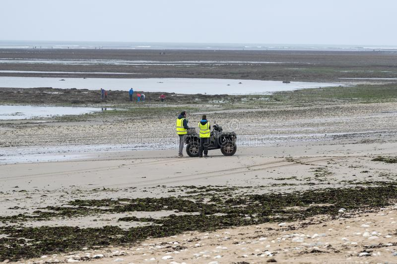 Security staff use a drone to search a beach. Île d `Oléron. France, 2018, Town House officials using a Quad and a drone, control the structure of a beach stock photography