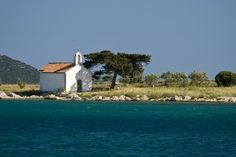Île Sveti Justin avec une petite chapelle photos libres de droits