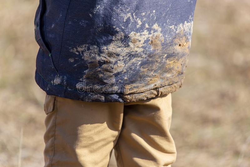 Ρύπος στο σακάκι του αγοριού στοκ φωτογραφίες