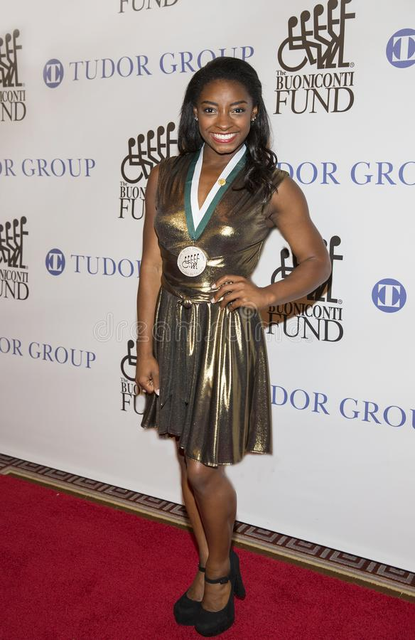 Simone Biles. Four-time Olympic Gold Medal Gymnast Simone Biles arrives for the 32nd Annual Great Sports Legends Dinner presented by Tudor Group at the New royalty free stock photos