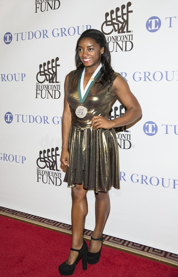 Simone Biles. Four-time Olympic Gold Medal Gymnast Simone Biles arrives for the 32nd Annual Great Sports Legends Dinner presented by Tudor Group at the New royalty free stock photography