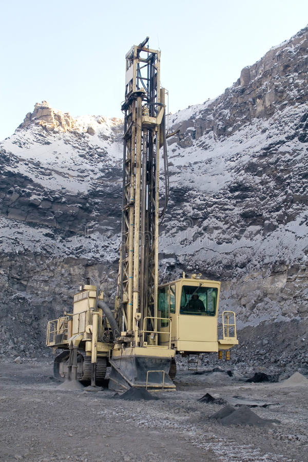 �DRILLING MACHINE. Heavy drilling machine at worksite royalty free stock image