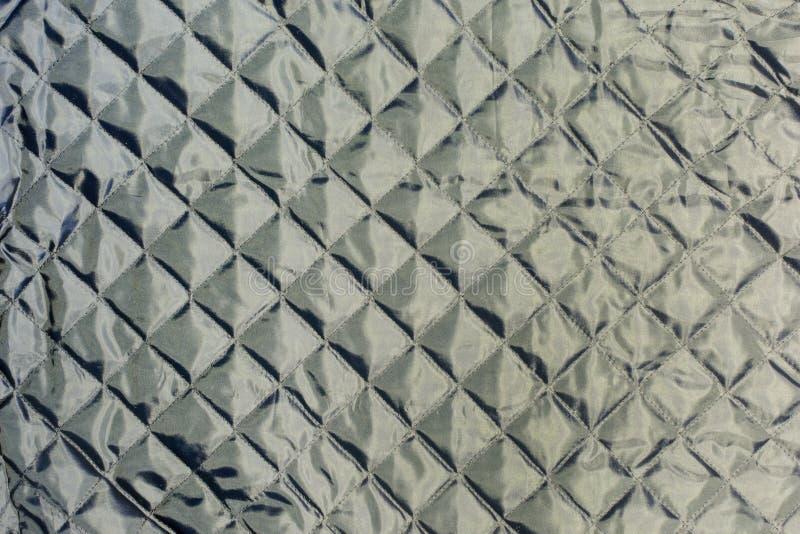 Σύσταση, σκούρο γκρι γεμισμένο ύφασμα κοντά επάνω σπειροειδές λευκό εγγράφου σημειωματάριων ανασκόπησης απομονωμένο κενό στοκ φωτογραφία με δικαίωμα ελεύθερης χρήσης