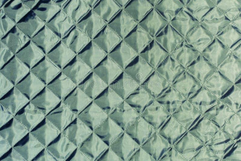 Σύσταση, σκούρο πράσινο γεμισμένο ύφασμα κοντά επάνω σπειροειδές λευκό εγγράφου σημειωματάριων ανασκόπησης απομονωμένο κενό στοκ εικόνα