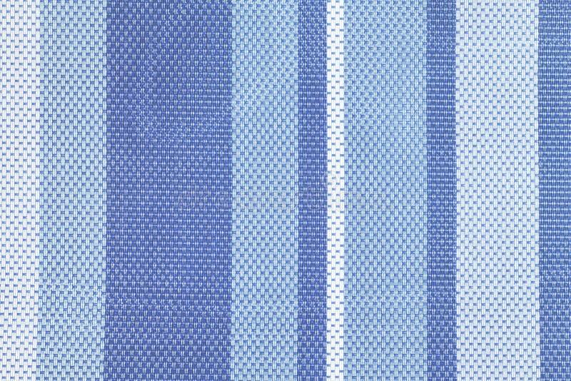 Σύσταση της μεγάλης ύφανσης κοντά επάνω Υπόβαθρο με τα ελαφριά και σκούρο μπλε λωρίδες textile στοκ φωτογραφίες