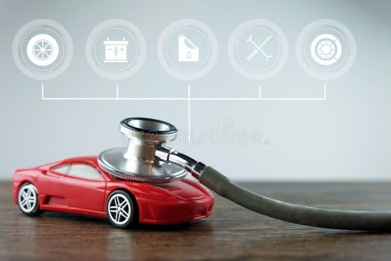 Στηθοσκόπιο και αυτοκίνητο με τα εικονίδια υπηρεσιών στο ξύλινο υπόβαθρο, την έννοια του αυτοκινήτου που ελέγχει, την επισκευή κα διανυσματική απεικόνιση
