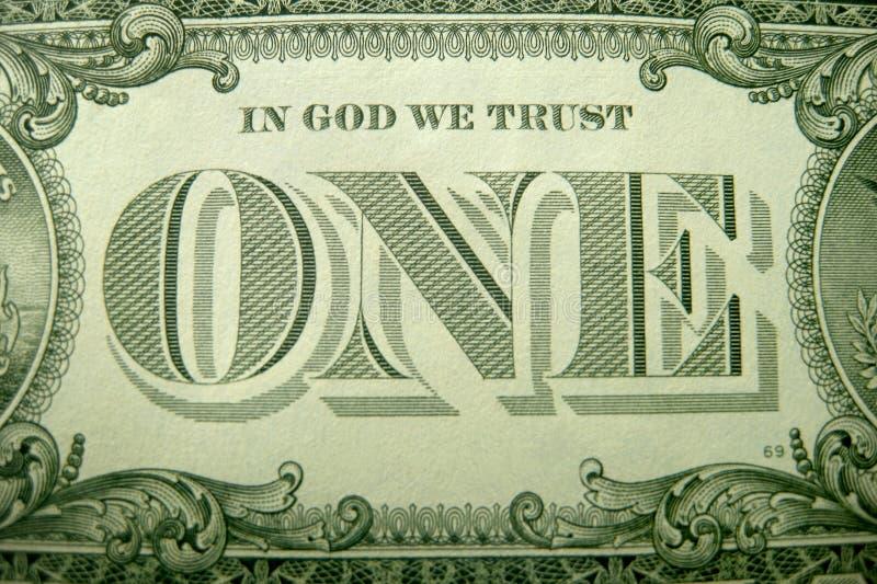 Στο ΘΕΟ ΕΜΠΙΣΤΕΥΟΜΑΣΤΕ και ΕΝΑ που πλαισιώνεται ornately από τα διακοσμητικά στοιχεία από το αμερικανικό δολάριο στοκ εικόνες με δικαίωμα ελεύθερης χρήσης