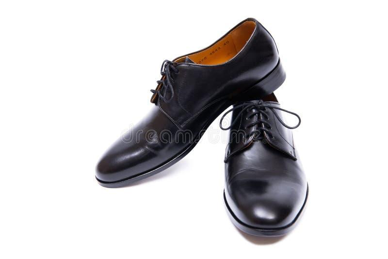 Τα μαύρα παπούτσια που απομονώνονται στο άσπρο υπόβαθρο στοκ φωτογραφία με δικαίωμα ελεύθερης χρήσης