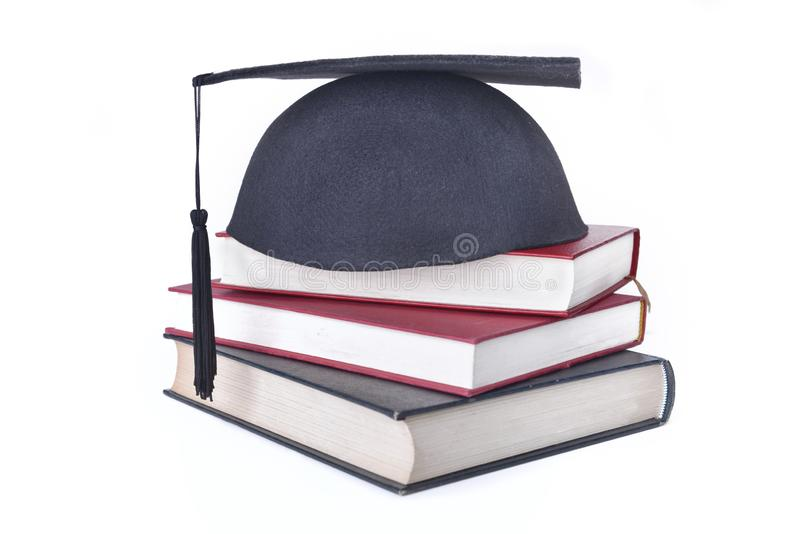 τεθειμένα ΚΑΠ βιβλία που συσσωρεύονται που απομονώνονται στο άσπρο υπόβαθρο στοκ φωτογραφία