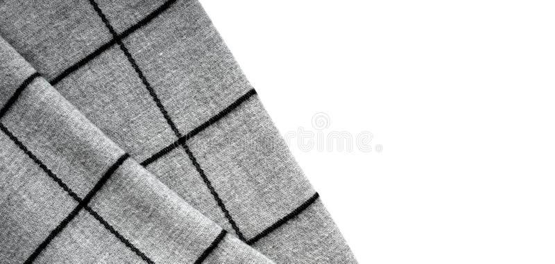 Τοπ άποψη της σύστασης του γκρίζου υφάσματος σε ένα μεγάλο κύτταρο σε ένα άσπρο υπόβαθρο με μια περιοχή για το κείμενο στοκ εικόνες