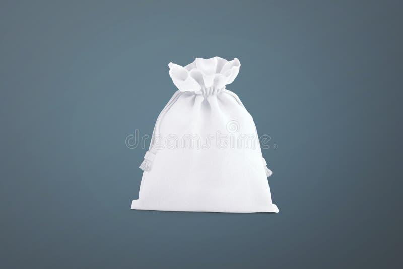 Τσάντα Drawstring στο υπόβαθρο Μικρή τσάντα βαμβακιού υφάσματος Απομονωμένη σακούλα στοκ φωτογραφία με δικαίωμα ελεύθερης χρήσης