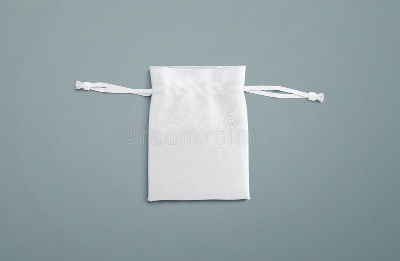 Τσάντα Drawstring στο υπόβαθρο Μικρή τσάντα βαμβακιού υφάσματος Απομονωμένη σακούλα στοκ εικόνες
