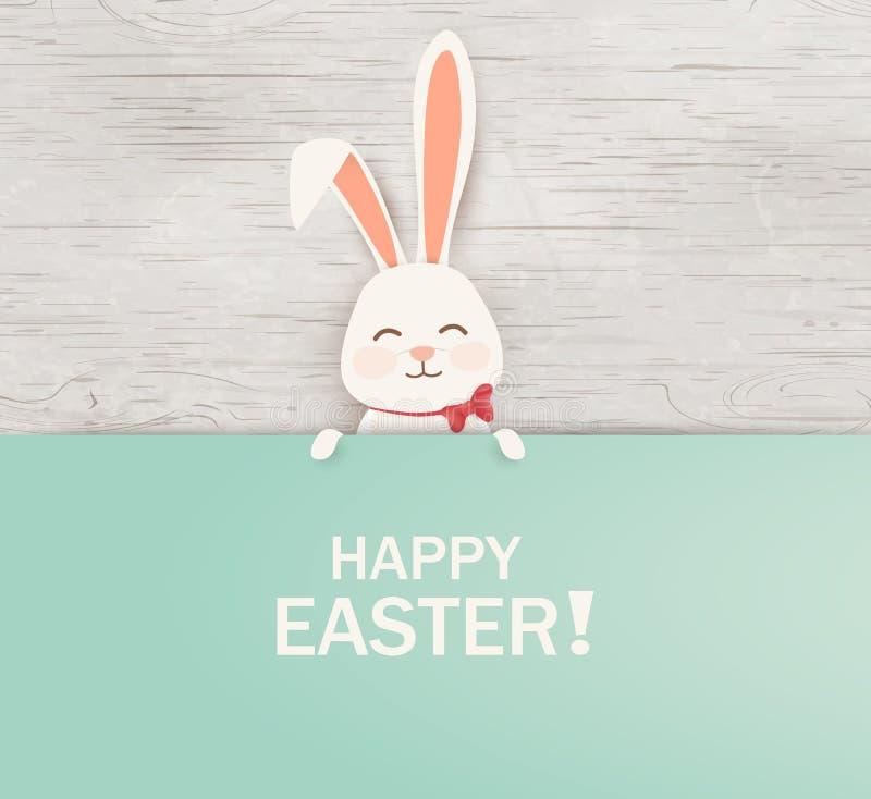 Πάσχα ευτυχές Λαγουδάκι κουνελιών Πάσχας που στέκεται πίσω από ένα κενό σημάδι, που παρουσιάζει στο μεγάλο σημάδι Ευτυχή χαριτωμέ ελεύθερη απεικόνιση δικαιώματος