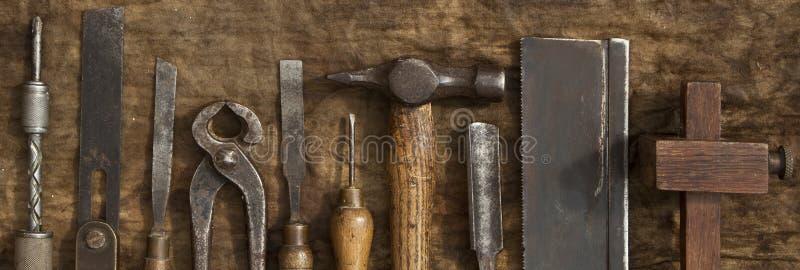 Παλαιό έμβλημα εργαλείων ξυλουργικής στοκ φωτογραφίες