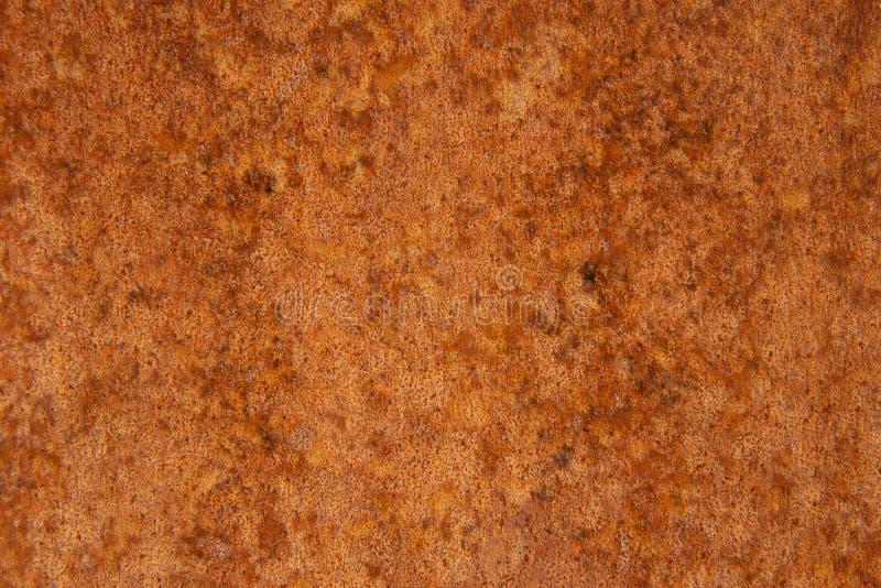 Παλαιό στενοχωρημένο καφετί σκουριασμένο πέτρινο υπόβαθρο χαλκού τερακότας με τους τραχιούς πολύχρωμους συνυπολογισμούς σύστασης  στοκ εικόνες