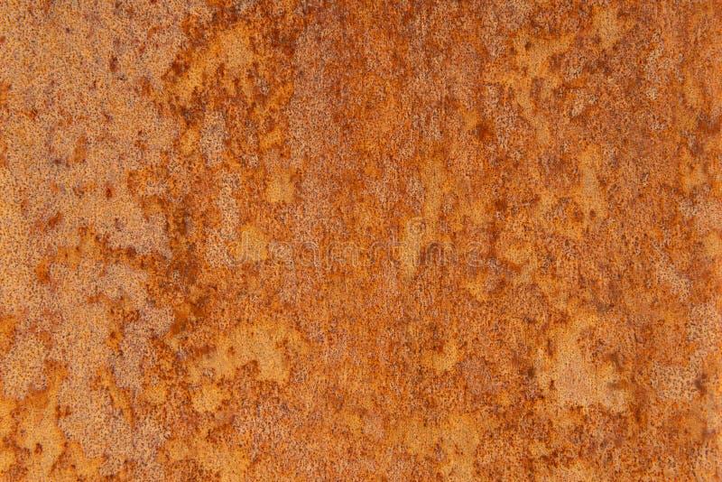 Παλαιό στενοχωρημένο καφετί σκουριασμένο πέτρινο υπόβαθρο χαλκού τερακότας με τους τραχιούς πολύχρωμους συνυπολογισμούς σύστασης  στοκ φωτογραφίες