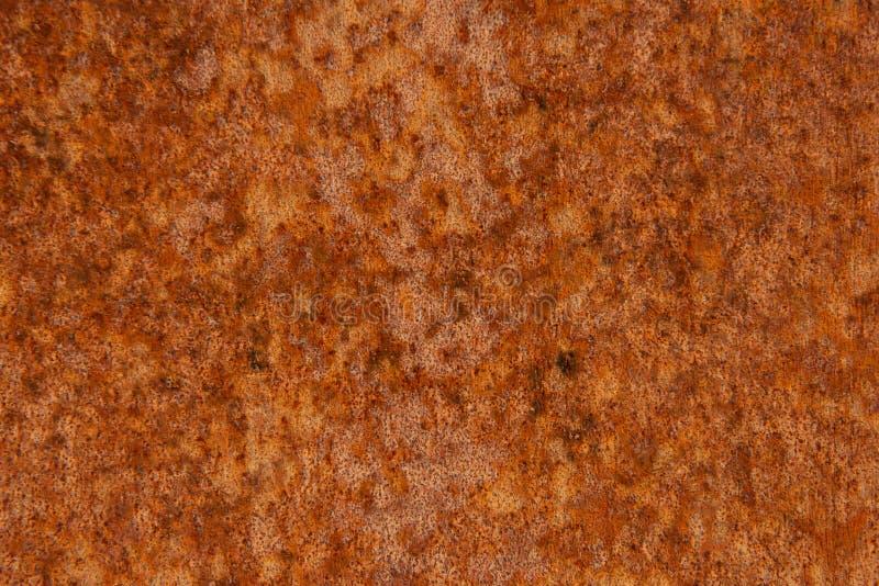Παλαιό στενοχωρημένο καφετί σκουριασμένο πέτρινο υπόβαθρο χαλκού τερακότας με τους τραχιούς πολύχρωμους συνυπολογισμούς σύστασης  στοκ εικόνες με δικαίωμα ελεύθερης χρήσης