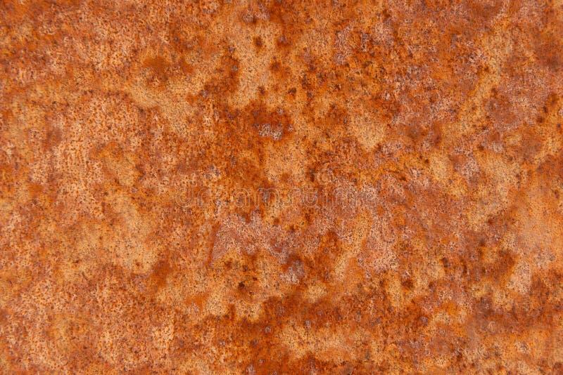 Παλαιό στενοχωρημένο καφετί σκουριασμένο πέτρινο υπόβαθρο χαλκού τερακότας με τους τραχιούς πολύχρωμους συνυπολογισμούς σύστασης  στοκ φωτογραφίες με δικαίωμα ελεύθερης χρήσης
