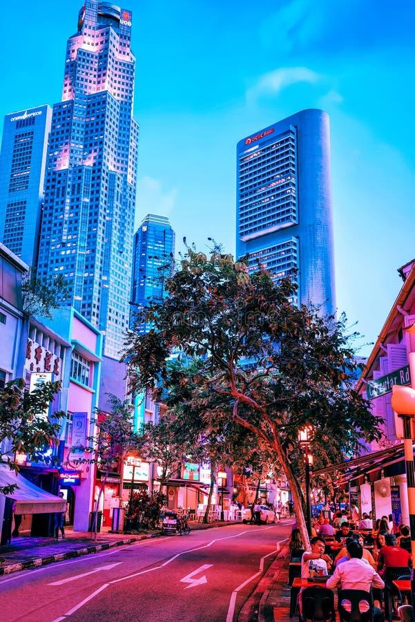 Περιοχή αποβαθρών βαρκών και νύχτα UOB Plaza Σιγκαπούρη στοκ εικόνες