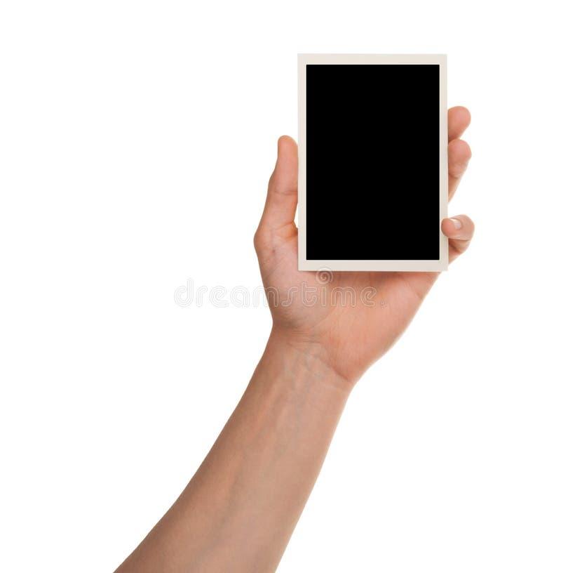 Πλαίσιο φωτογραφιών εκμετάλλευσης χεριών που απομονώνεται στο λευκό με το ψαλίδισμα της πορείας στοκ φωτογραφία