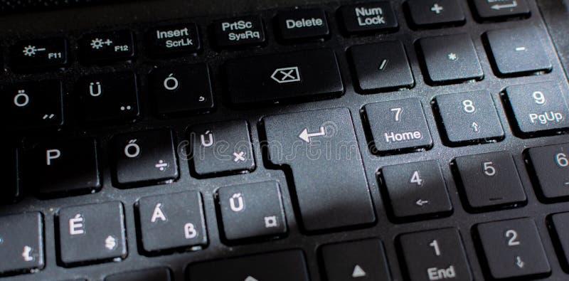 Πληκτρολόγιο lap-top, μαύρο πληκτρολόγιο Στενός επάνω πληκτρολογίων με τον ήλιο Ray στοκ εικόνα με δικαίωμα ελεύθερης χρήσης