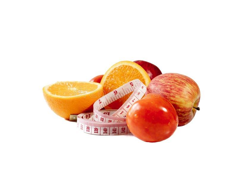 Πορτοκαλιά φρούτα, Apple, ντομάτα και ταινία μέτρου στοκ φωτογραφία με δικαίωμα ελεύθερης χρήσης