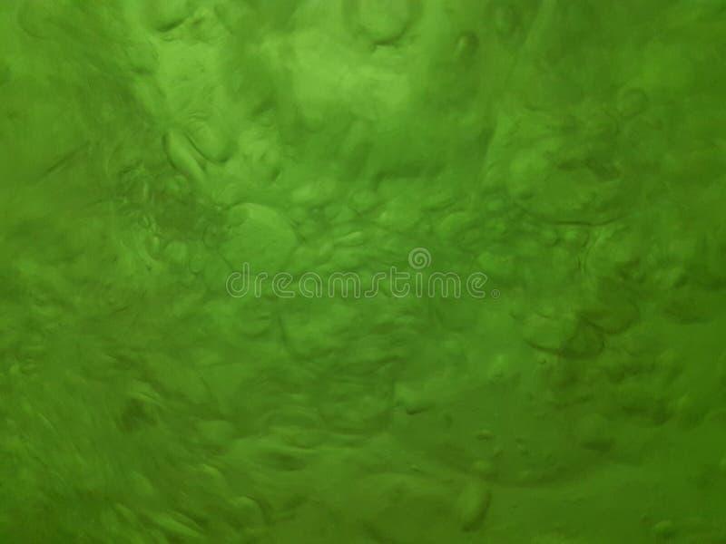 Πτώσεις νερού βρασίματος με τις σκιές πράσινου, σύσταση στοκ εικόνα