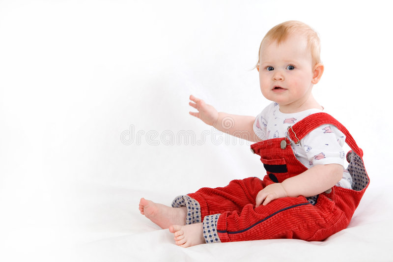 Нарру baby. Happy smiling baby 11 month old sitting stock photography