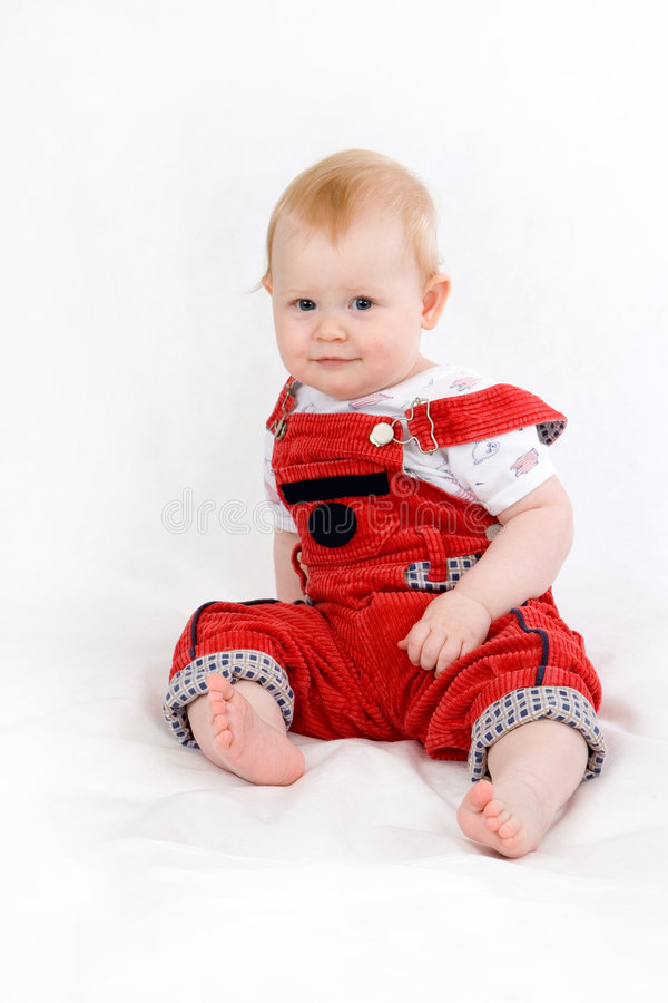 Нарру baby. Happy smiling baby 11 month old sitting royalty free stock images