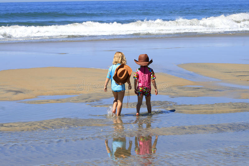 Ð¡hildren are walking at the beach royalty free stock photo