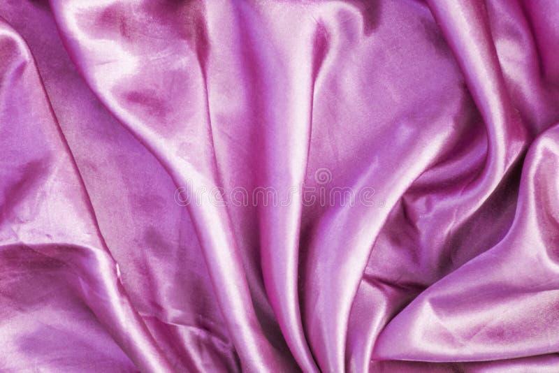 Абстрактная яркая розовая предпосылка Ровная текстура шелка с красивыми створками стоковые фотографии rf